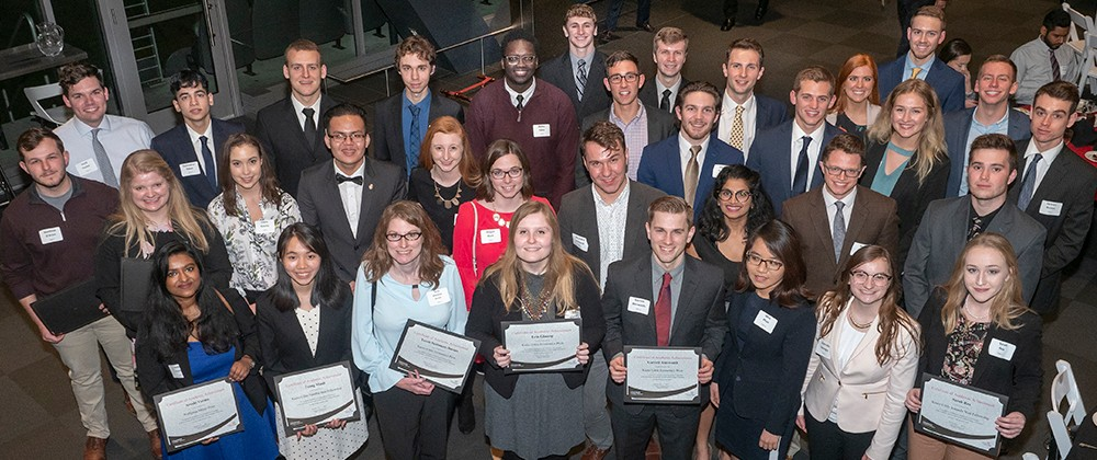 Overhead group photo of Economics award winners
