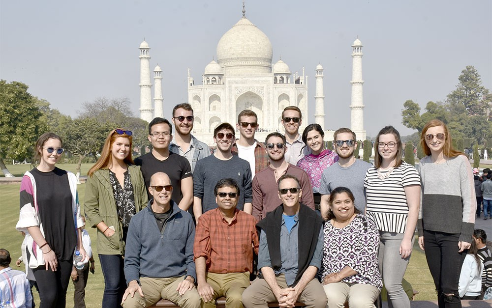 Economics students and faculty pose with Woodrow Uible and Daniel Kautz in front of the Taj Mahal