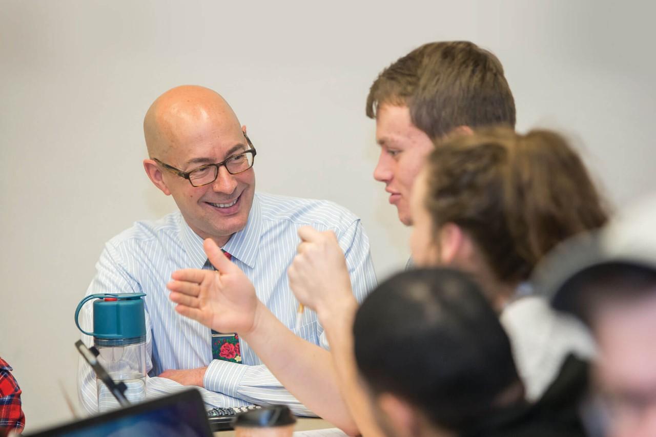 Marketing Professor Ric Sweeney conversing with students