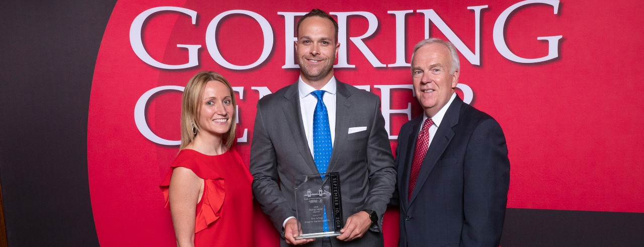 Kelly Backscheider receiving Rising Leader award, pictured with John Goering and Larry Grypp.