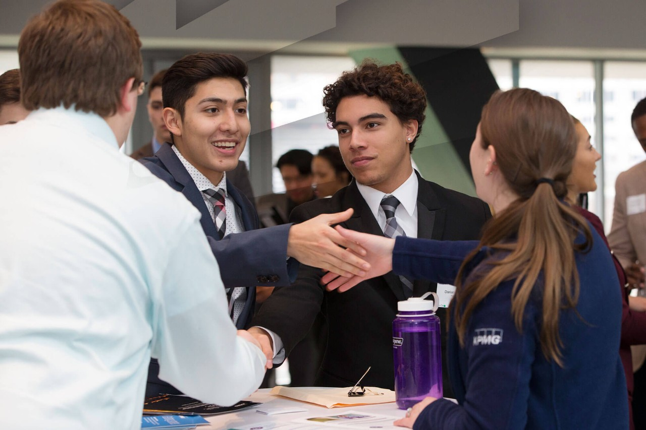 Lindner College of Business students greet one another